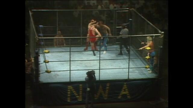 NWA: The Rock 'n' Roll Express vs Ivan Koloff and Nikita Koloff (Steel cage match)